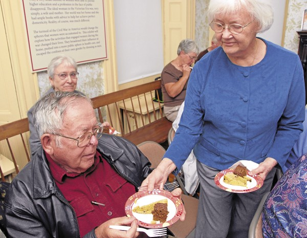 While attending the June 6 Brown Bag Series lecture on &quotLove and War in the Kitchen&quot at the Bangor Museum and History Center, Judy Boothby of Bangor serves two types of cake to her husband, Charles. The cakes were made from recipes published in &quotThe Sanitary Fair Cookbook Bangor 1864,&quot published 148 years and scheduled to be re-released this summer. The book includes 99 recipes based on food items that Bangor-area women prepared for a fund-raising effort to support the war in late 1864.