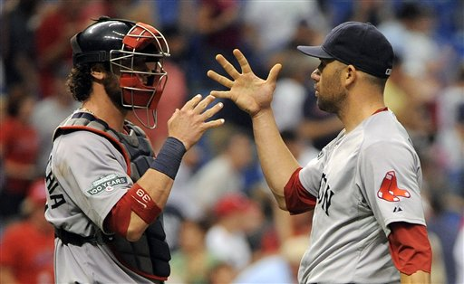 Boston Red Sox catcher Jarrod Saltalamacchia, left, and pitcher Alfredo Aceves celebrate their 7-3 win over the Tampa Bay Rays at the end of a baseball game, Sunday, July 15, 2012, in St. Petersburg, Fla.