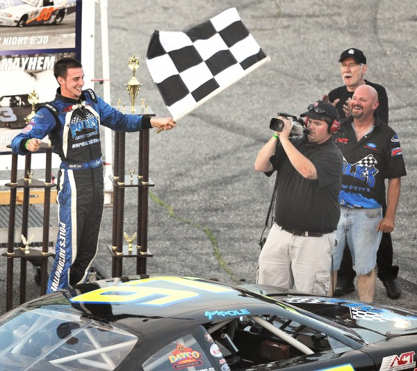 Joey Polewarczyk Jr. of Hudson, N.H., celebrates his victory after winning Sunday's TD Bank 250 at Oxford Plains Speedway.