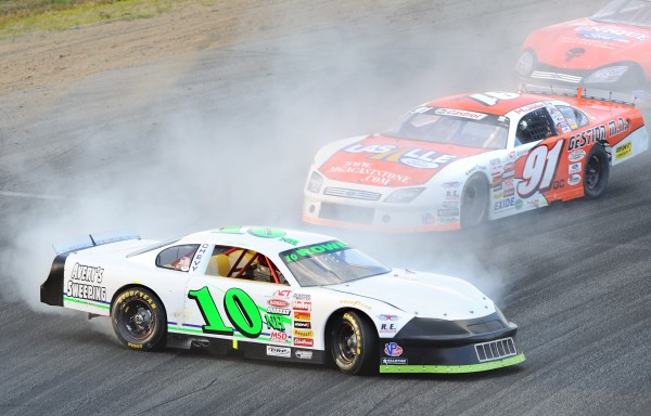 Patrick Laperle (center) of St. Denis, Quebec, tries to avoid a spinning Ben Rowe of Turner during Sunday's TD Bank 250 at Oxford Plains Speedway.