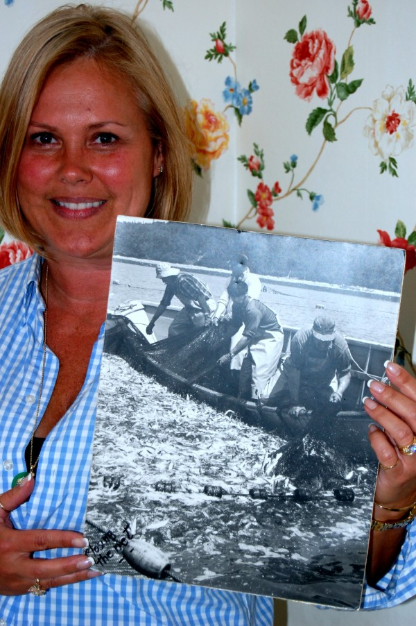 Brenda Chandler holds the photo of her grandfather that was used as an artistic template for a unique art-on-tile mural installed Thursday in his former Jonesport home.