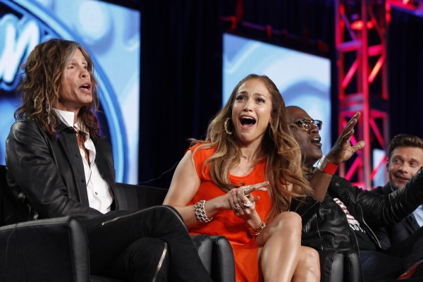 In this Jan. 8, 2012 photo, &quotAmerican Idol&quot judge Jennifer Lopez, center, reacts as fellow judge Steven Tyler, left, of Aerosmith makes a joke about wearing Lopez's pants as Randy Jackson and Ryan Seacrest are seen at right during the &quotAmerican Idol&quot panel at the Fox Broadcasting Company Television Critics Association Winter Press Tour in Pasadena, Calif.