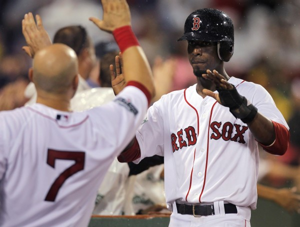 Boston Red Sox's Pedro Ciriaco is welcomed to the dugout after scoring on an error by Detroit Tigers second baseman Omar Infante in the fourth inning of a baseball game at Fenway Park, in Boston on Tuesday night, July 31, 2012.