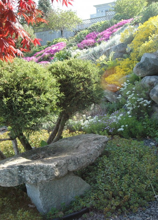 The Tucker-Kulik garden features a terraced hillside of perennials and stonework along with a view of the ocean.