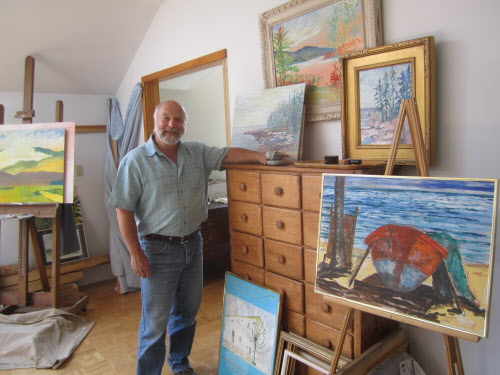 Thom Hope in his studio with works in progress.