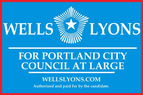 A campaign sign for Wells Lyons.