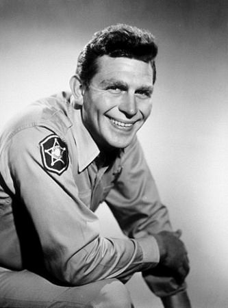 Andy Griffith in one as his most famous roles, Andy Taylor, a widowed sheriff in the fictional community of Mayberry, N.C.