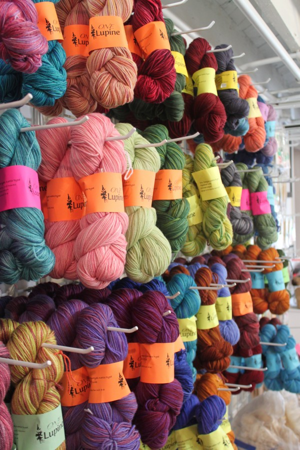 Jodi Clayton, fiber artist and owner of One Lupine Fiber Arts, launched her own line of &quotOne Lupine&quot yarn, mixes of wool, silk and bamboo fibers, March 2012, to be sold at her boutique and fiber shop in downtown Bangor.