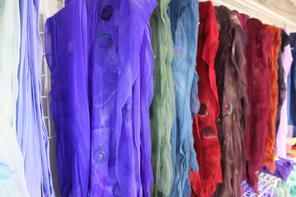 Felted silk scarves and wraps designed by Jodi Clayton, fiber artist and owner of One Lupine Fiber Arts, are lined up by color in Clayton's studio in downtown Bangor on June 26, 2012. Many of the felted silk pieces will be on sale at Arts in the Park, scheduled for July 7-8 in Heritage Park in Belfast.