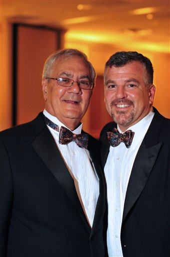 U.S. Rep. Barney Frank (left), D-Mass., and Jim Ready of Ogunquit, Maine, pose at their wedding reception Saturday, July 7, 2012. Frank married his longtime partner in a ceremony officiated by Massachusetts Gov. Deval Patrick in Newton, Mass. Saturday.