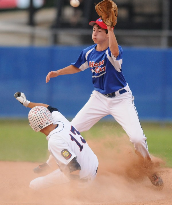 Bangor's Christian Cornell slides safely into second base as Motor City second baseman Cody Collins gets the ball too late to thwart the stolen base during first inning action on Monday, July 16, 202 at Mansfield Stadium in Bangor.