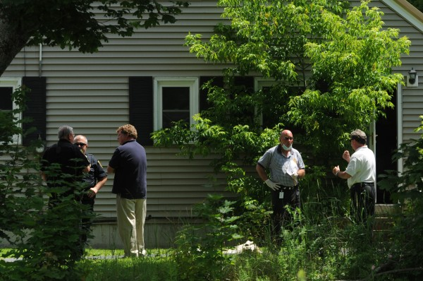 Brewer city officials, police and fire officials wait outside 21 Tibbetts St. in Brewer on Tuesday, July 3, 2012. An elderly man was removed from the structure and taken to the hospital. Brewer officials are in the process of condeming the house.