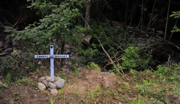 A cross marks the area where Charles Bromiley died on June 24, 2012 when he drove onto a washed-out section of Pleasant River Road in Milo during the flooding.
