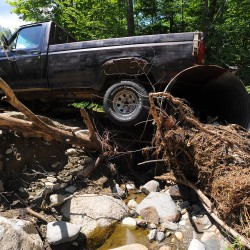 A driveway was washed away from under a pickup that was parked over the culvert along Stickney Hill Road in Brownville. The repair work after the recent flooding has created a huge financial burden for the town of Brownville. Town Manager Matthew Pineo is asking Gov. LePage to release funds to help the town in the wake of the severe flooding.