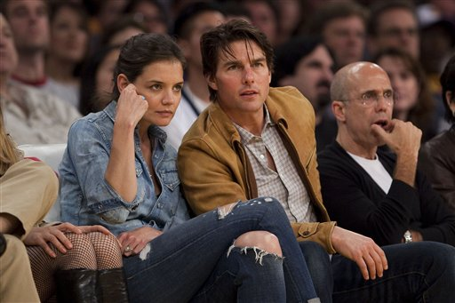 Katie Holmes and Tom Cruise watch the Minnesota Timberwolves play the Los Angeles Lakers in an NBA basketball game, in Los Angeles, in 2010.
