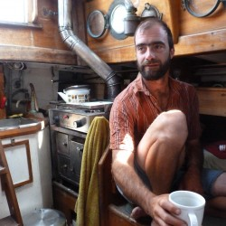 Daniel Bennett, 36, of Rockland, sets in the cabin of his 36-foot sloop, Bufflehead in July 2012. Bufflehead is in its first season working as a charter boat.