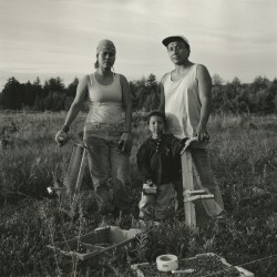 Photograph taken in 2001 by David Brooks Stess of Javier and his family, workers from Mexico, at the Dickens Farm in Eastbrook, Maine. The photograph is part of new exhibition to open at the Tides Institute & Museum of Art that features a selection from the institute's collections to celebrate its first 10 years in operation.