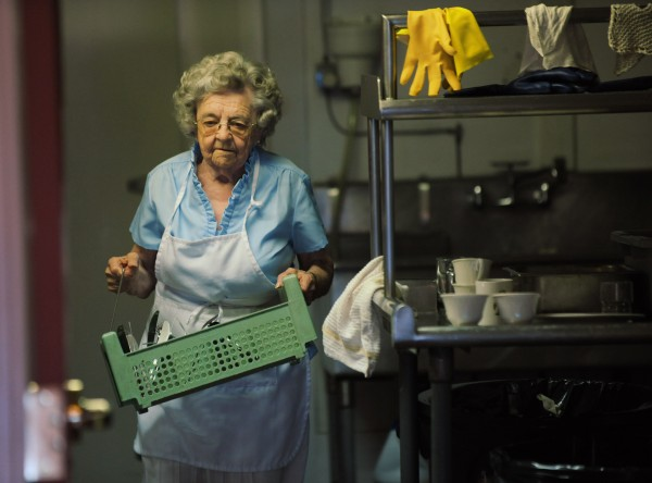 Ethel Cunningham brings clean silverware from the kitchen to the dinning room at a senior housing complex formerly known as the Jed Prouty Inn on Main street in Bucksport on Monday, July 9, 2012. Cunningham is 88 and still an active member of the work force.