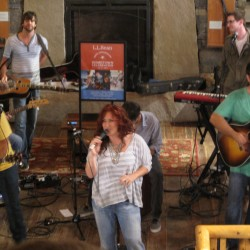 Jo Dee Messina performs in the L.L. Bean store in Freeport on Wednesday.