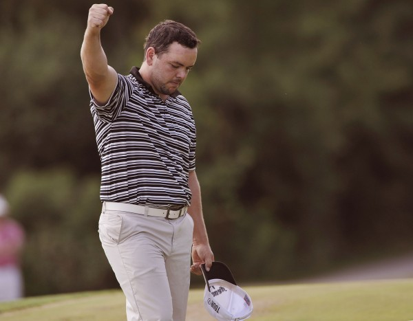 Will Mitchell gestures on the eighteenth hole as he clinches the win of the GBO tournament in Bangor, Maine, Saturday, July 21, 2012.