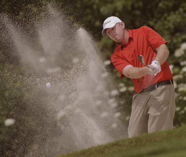 Jason Harvey comes out of the hazard on the eighteenth hole during play of the final day of the GBO in Bangor, Maine, Saturday, July, 21, 2012.