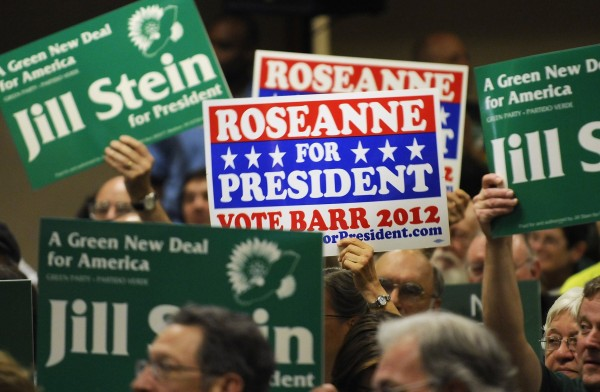 Delegates show their support for presidential candidates Dr. Jill Stein and actress Roseanne Barr at the Green Party presidential nominating convention in Baltimore, Md., July 14, 2012.