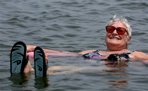 Lillian Mariscalo of Oyster Bay, N.Y., cools off in the waters of an Oyster Bay beach on Long Island's North Shore on Saturday, July 7, 2012.