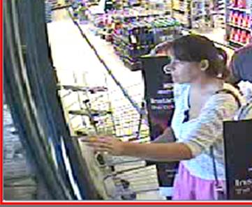 A video surveillance image shows a woman at the Bangor Walmart that police believe was involved with a theft of credit cards and merchandise purchased with the stolen cards.