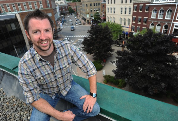 Chris Rudolph, 35, director of marketing and community outreach for Bangor Greendrinks. Kah-Bang music and arts festival hospitality and development partner and board member. Rudolph poses for a portrait atop a building overlooking downtown Bangor on Friday, July, 20, 2012.