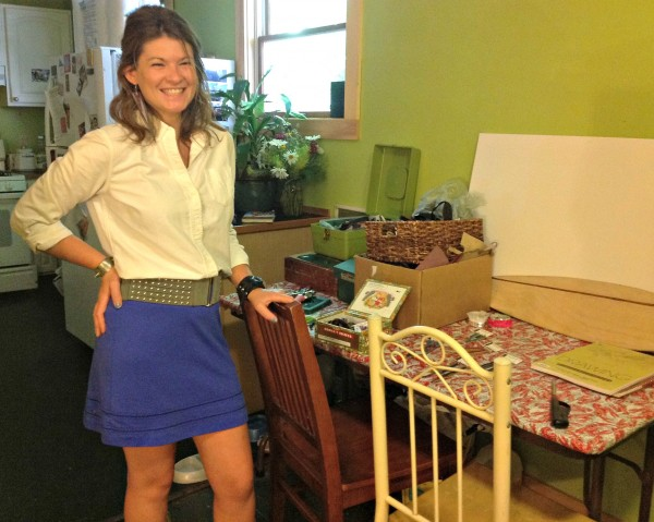 Emma Thieme, owner of Local Girl Leather, stands next to her workspace in her apartment.