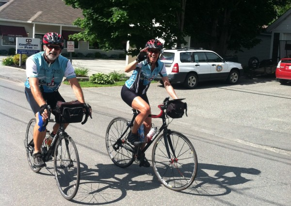 Jeff Furnia (left) and Ann Tardy ride down School Street in Ellsworth on Monday, July 2, 2012. The pair was wrapping up their 2,700-mile cycling trip from Key West, Fla., to Bar Harbor.