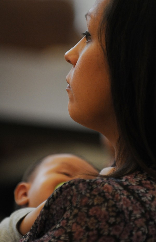 Naya Mitchel sits with her child Benally while listening to a seminar about breast feeding on Indian Island on Tuesday, July 17, 2012. Mitchell will act as a peer counselor and take the information she learns back to other members of her tribe.