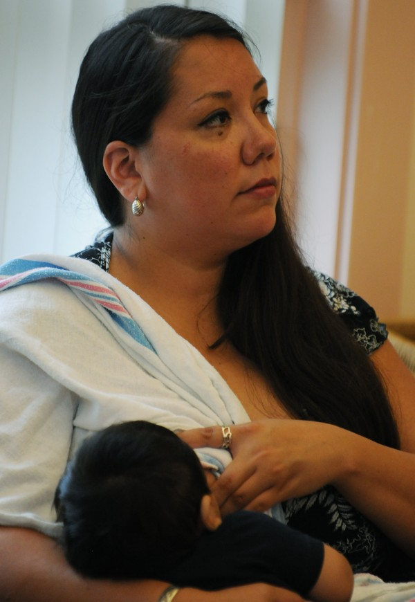 Alexandra Francis breast feeds her child Silas while listening to a seminar about breast feeding on Indian Island on Tuesday, July 17, 2012. Francis will act as a peer counselor, educating others in her tribe on the benefits of breast feeding.