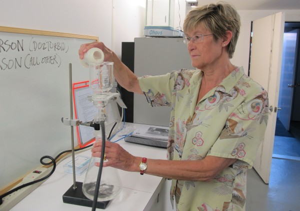 Dr. Susan Shaw, CEO and President of Marine Environmental Research Institute, demonstrates the procedure for processing microplastic samples at the institute's Blue Hill laboratory on July 12, 2012.