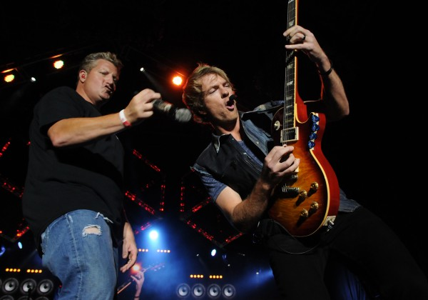 Gary LeVox (left) and Joe Don Rooney (right) of Rascal Flatts thrill a crowd of over 8,000 country fans at the Bangor Waterfront on Friday, July 6, 2012.