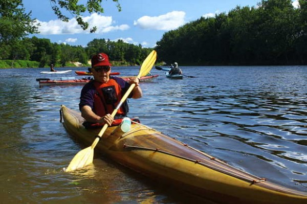 Perry Risley of Bethel kayaks down the Androscoggin River on Thursday during the Androscoggin Source to the Sea Trek.