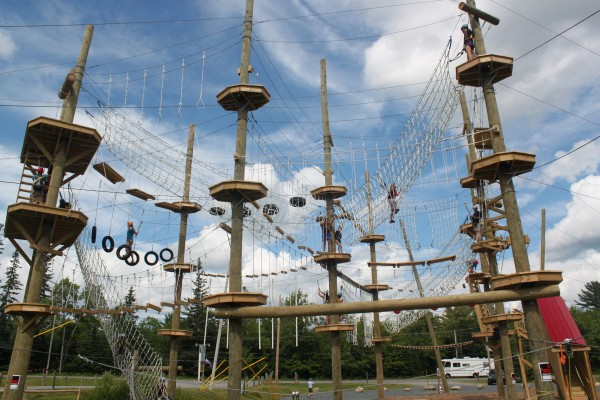 Visitors to the Wild Acadia Fun Park in Trenton climb through the ropes course, the Aerial Adventure, on July 6, 2012. The ropes course and zip line are new to the park this summer.