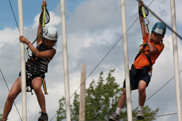 Grace Gong, 11, and Samuel Chen, 10, both of Acton, Mass., navigate the ropes course at Wild Acadia Fun Park in Trenton on July 6, 2012. The ropes course, the Aerial Adventure, and zip line are new to the park this summer.
