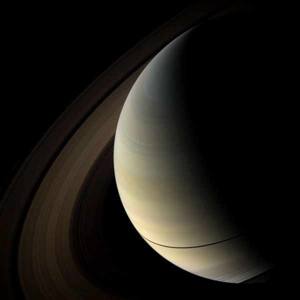 Saturn's rings cast shadows near the planet's equator as it approaches its equinox in August 2009.