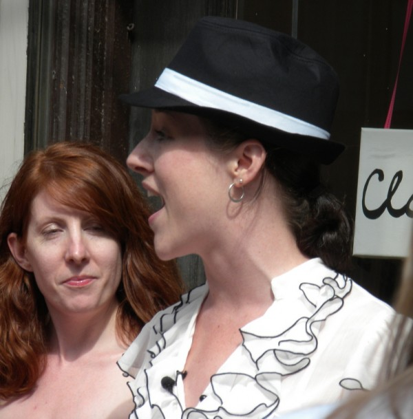 Audrey Slade (right) welcomes supporters of Sweetest Thing Weddings to Bangor's first &quotcash mob&quot event on Thursday, July 5, 2012. The Columbia Street boutique and event designing service, owned by Kathryn Ravenscraft (left) and Amber Small was burglarized last week and the event was organized to help the women replace some of the $4,000 worth of electronic equipment and cash that was stolen.