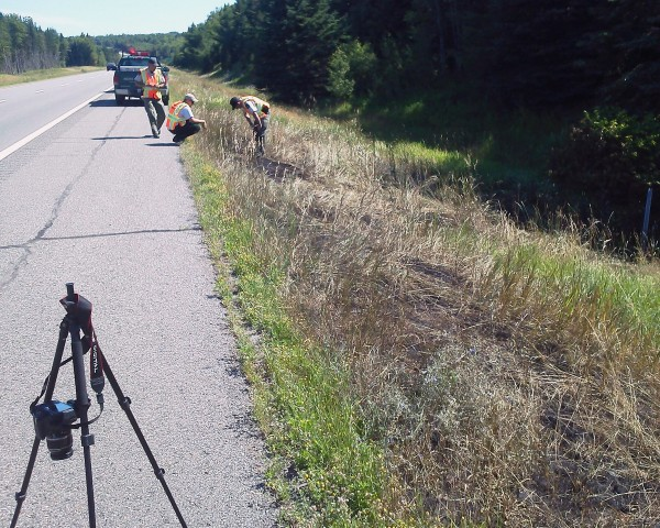 Maine Forest Service Rangers map damage and collect evidence along Interstate 95's northbound lane in the area of Benedicta on Wednesday, July 1, 2012. As many as 30 grass fires occurred when a truck leaked burning materials onto the road the day before.