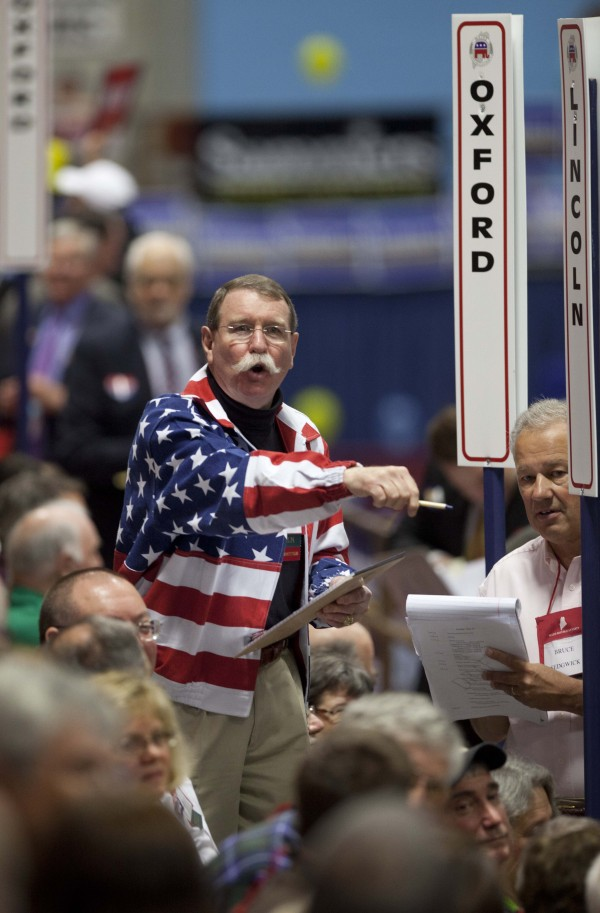 James Carlton of the Lincoln County State Committee counts votes of his county's delegates during the election of national committeemen at the Maine Republican Convention at the Augusta Civic Center on May 5, where Ron Paul supporters dominated the day.
