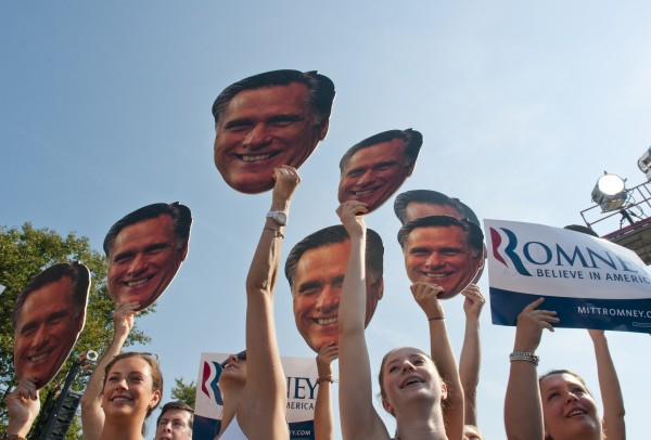 Supporters of Republican presidential candidate former Massachusetts Gov. Mitt Romney hold up cutouts of Romney's head while listening to him address a crowd of supporters Friday, Aug. 24, 2012, in Commerce Township, Mich.