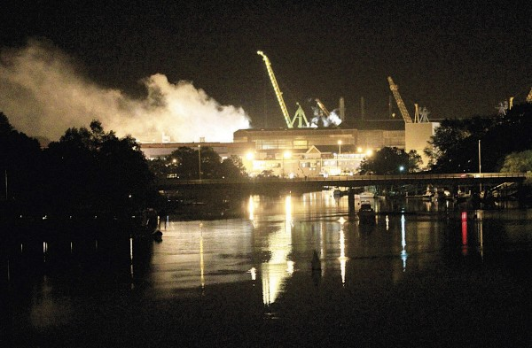 Smoke rises from a dry dock as fire crews respond Wednesday, May 23, 2012 to a fire on the USS Miami SSN 755 submarine at the Portsmouth Naval Shipyard in Kittery, Maine. Four people were injured.