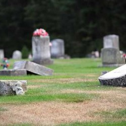 """It looked like a tornado came through here,"" Erica Poland said of the vandalism at Pleasant View Cemetery in Livermore Falls on Monday evening as she again checked the grave of her infant son buried there. Vandals swept through the area, breaking solar lights, flags, statues and knocking over the stones."