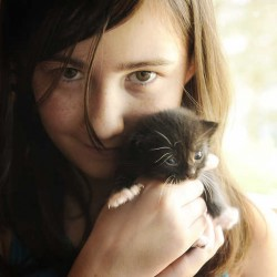 Katie Nichols 10, of Auburn, holds a kitten she named Scamper. Katie and her mother, Laurie Nichols, have been taking care of one of the kittens that were left in a Dumpster. A Lewiston woman has been charged with dumping the kitten.