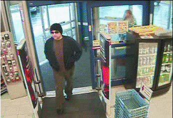 A surveillance picture of the man suspected of robbing a Rite Aid pharmacy in Newport on Thursday.