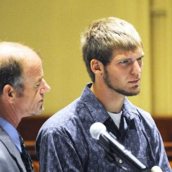 Joshua Michaud of Mechanic Falls, standing with his attorney, Allan Lobozzo, apologized for his actions during his sentencing for arson Monday in Androscoggin County Superior Court in Auburn.