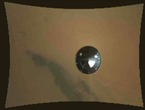 In this frame provided by NASA of a stop motion video taken during the NASA rover Mars landing, the heat shield falls away during Curiosity's descent to the surface of Mars on Sunday, Aug. 5.