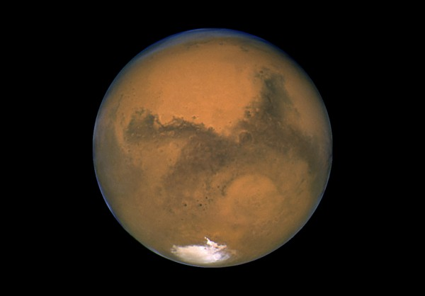 This Aug. 26, 2003 image made available by NASA shows Mars photographed by the Hubble Space Telescope on the planet's closest approach to Earth in 60,000 years. NASA's robotic rover Curiosity landed safely on Mars late Sunday, Aug. 5, 2012 to begin two years of exploration. The mission cost $2.5 billion.
